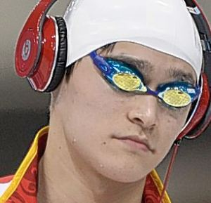 China's Sun Yang arrives to compete in the men's 400m freestyle final swimming event at the London 2012 Olympic Games on July 28, 2012 in London. He won gold. AFP PHOTO / FABRICE COFFRINIFABRICE COFFRINI/AFP/GettyImages