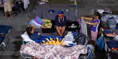 Evacuees from the Fort McMurray wildfires rest at the evacuation centre in Lac la Biche, Alta., Thursday, May 5, 2016. THE CANADIAN PRESS/Jeff McIntosh
